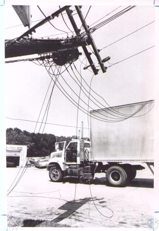 Image: di33159 - Delivery truck hit low wires in Reeves Drive In Parking Lot