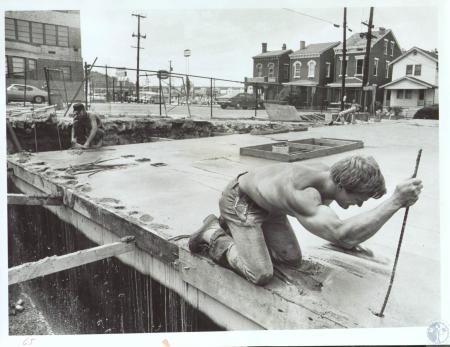 Image: di33935 - Rod Unkraut (21) working on new liquor store behind 3rd district school