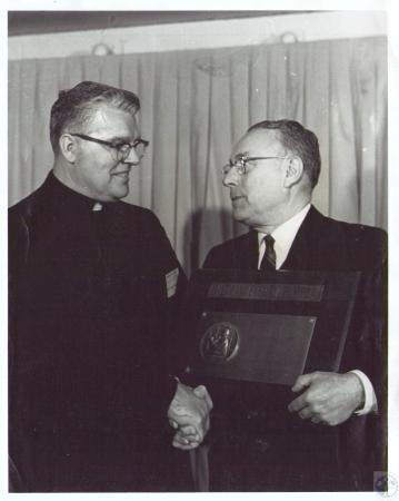 Image: di36361 - Fr. Ralph W. Beiting receiving American Exemplar Medal from Dr. Kenneth D. Wellsq