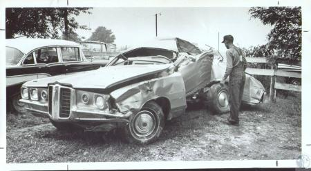 Image: di36951 - Harry Sidebottom of Brooksville looking over car in which three teenagers perished