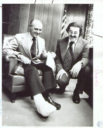 Image: di37089 - Thomas F. Schnorr (65) and Mark Hanna (30). Looking at broken leg in Shnorr office