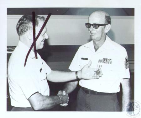 Image: di37667 - Chief Master Sgt. James Carr receiving commendation medal.