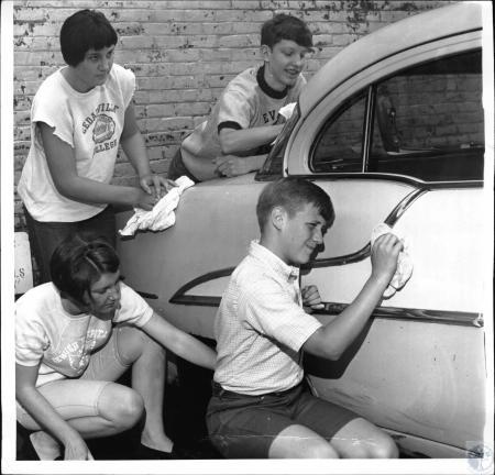 Image: di38464 - Chris Berwanger (standing), Greg Harpe (kneeling), Pat Conley (kneeling), Joe Conley (standing)