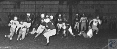 Image: di42726 - Dixie Heights High - Bob Likes, at fullback, with the carry while Bill Schmidt throws the lead block