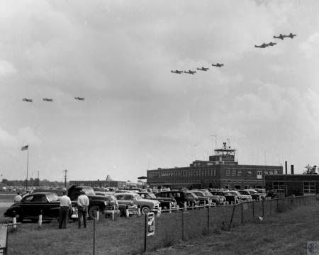 Image: di43976 - flyover at air show; airport terminal on right