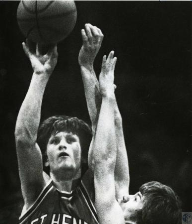 Image: di44234 - St. Henry's Bill Rice shoots, defended by unidentified Newport Central Catholic defender