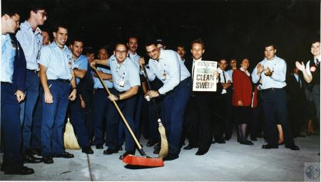 Image: di45444 - Delta Airlines employees await return of Cincinnati Reds; sweepers Brian Beutel and Mike beetem, while....
