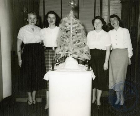 Image: di48872 - Martha Schroder(1st on left) and unidentified women around Christmas tree
