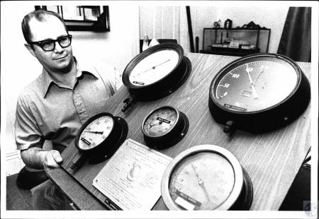 Image: di50159 - Mickey Frye with steamboat gauges from different boats.