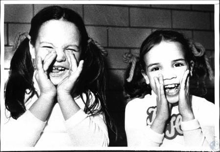Image: di53292 - Cathy Carr (6) and Heather Harris (6) cheering for Holmes High School at Newport Catholic gym