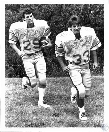 Image: di54053 - Two members of Newport Central Catholic High School football team