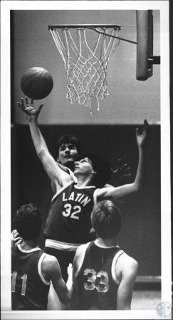 Image: di54237 - Covington Latin High School Basketball Player going for the rebound