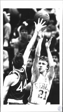 Image: di54327 - Boys Boone County High School Basketball Player (white uniform)