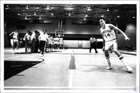 Image: di54519 - Roger Ryan #14, Northern Kentucky University Basketball, runs thru drill while others watch