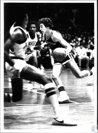 Image: di54532 - Thomas More's Mike Schmidt with ball against Xavier