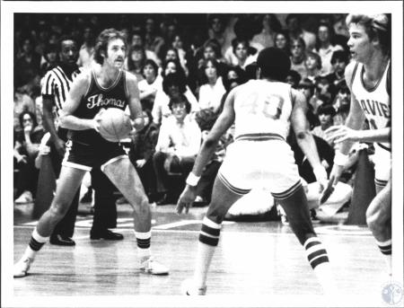 Image: di55575 - College basketball game, Thomas More vs. Xavier. T.M.C.'s Ken Hicks with ball