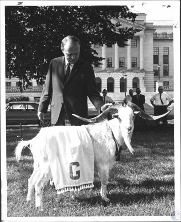 Image: di57085 - Governor Edward T. Breathitt poses with billy gaot to indicate what's in store for his when he has to....