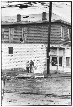 Image: di58407 - Della Antle's apartment building at 1480 South 9th St on corner of 9th and hill. Passers by look at street.....