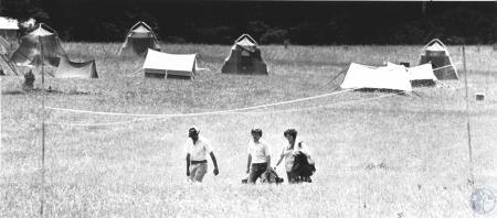Image: di58588 - Dick Boisvert (31), William Offenheiser (19), Pat Miller (22) walking toward the mess tent after doing....