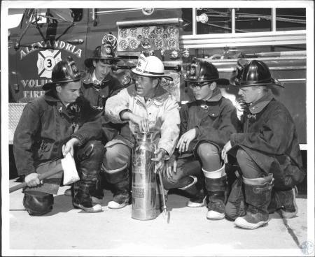 Image: di60781 - L-R: David Fries (17), George Freudenberg (17), Mrs. Arthru Woeste, Assistant Fire Chief, David Woeste....