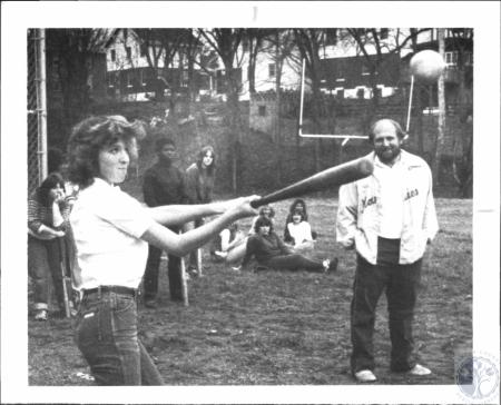 Image: di61645 - Tina Conner at bat. Looking onis Holmes High School teacher Runge
