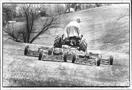 Image: di62346 - Sonny Craig cutting golf course to help out his friend Jerry Huber, the pro at Devou. Jerry's tractor....