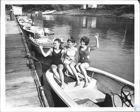 Image: di64601 - Miss Carroll County Fair 1968m Miss Patti McCormick, poses with two friend on marina on Carrollton's....