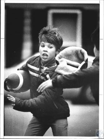 Image: di65015 - Scott Perkins playing football with friends and being chased by J.D. Hawks.
