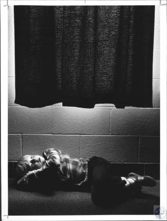 Image: di65196 - Greg Oaks (5) xozies up udner a window during rest period in Jackie Wolfe's kindergarten class at Northern....