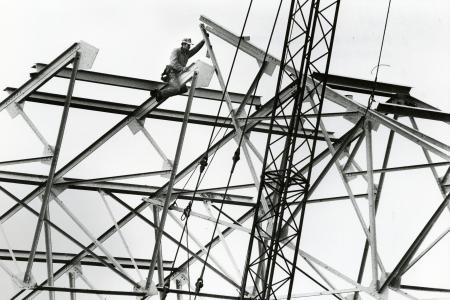 Image: di71770 - Unknown worker directing metal girder into place