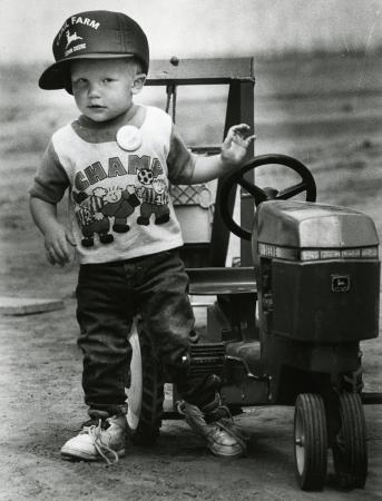 Image: di71841 - Tractor pulling is serious business to this unknown man. His father, uncles and other family are heavy....