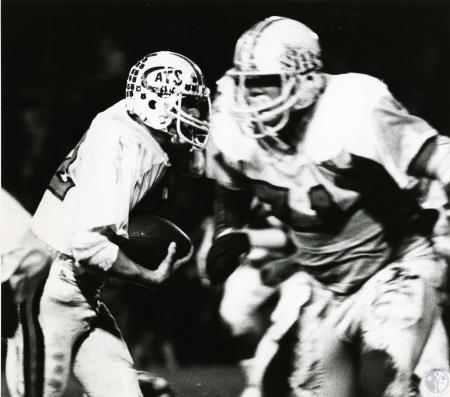 Image: di72203 - Unknown Newport High School football players in action