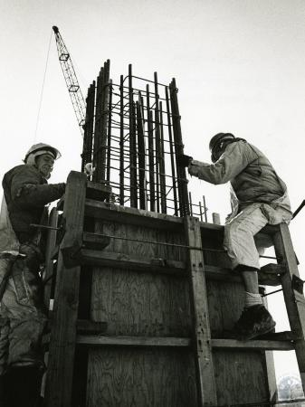 Image: di73204 - Unidentified workers building concrete form.