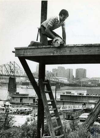 Image: di73244 - Unidentified man, Cincinnati in background.