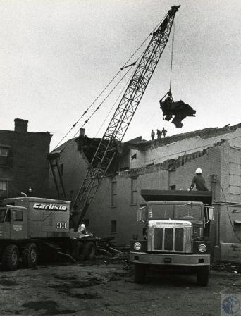 Image: di73266 - Unidentified workers using crane to remove item from top of demolished building.