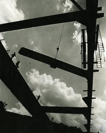 Image: di73393 - Unidentified laborers working on girders of building.