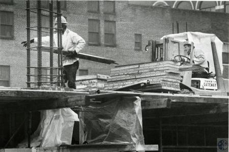 Image: di73641 - Unidentified worker of Warm Bros. Construction working on City parking garage.