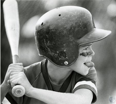 Image: di74553 - Unidentified young baseball player at the peak of concentration.