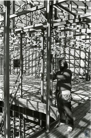 Image: di74556 - Unidentified carpenter checking post for plumb.
