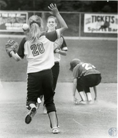 Image: di74594 - A couple of unidentified Notre Dame softball players congragulating each other on a good play.
