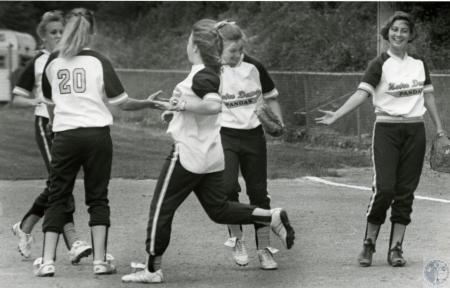 Image: di74595 - Unidentified Notre Dame softball players congragulating each other on the win.