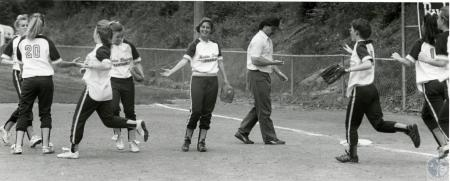 Image: di74596 - Unidentified Notre Dame Academy softball players congratulating each other on the win.