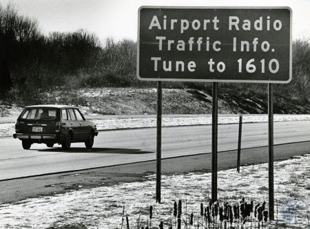 Image: di74926 - The sign tells motorists headed for Greater Cincinnati Airport that they can get infor about traffic,....