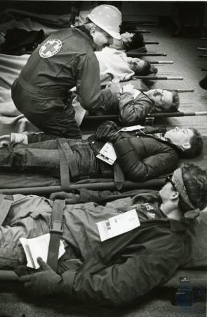 Image: di74932 - Unidentified Red Cross worker makes sure some of the unidentified