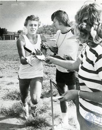 Image: di75192 - Unknown cross coutnry runner, timekeeper and race volunteer