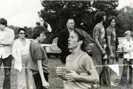 Image: di75197 - Unknown cross country runner and spectators in background.