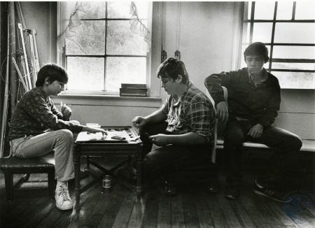 Image: di75234 - Three unidentified boys, two plaing board game.