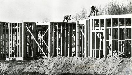 Image: di75411 - Unknown carpenters framing up building.