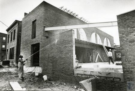 Image: di75546 - Unknown laborers working on brick building.