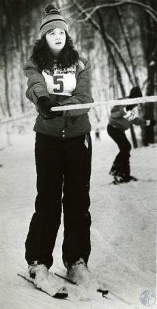 Image: di75634 - Unidentified female KY Winter Olympic participant being pulled uphill